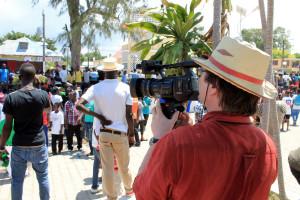 Michael films an event in Haiti