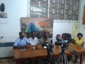 Representatives from the Collective and KOPI (of Île-à-Vache) and family members of imprisoned Lamy speak to the press. Photo by: Jessica Hsu