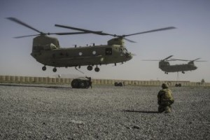 Deep into the drawdown, fuel is no longer distributed to smaller bases by road — it is too dangerous and there aren't enough trucks. Two Chinooks at Kandahar Airfield prepare to deliver fuel containers to a small contingent of troops at FOB Apache in neighboring Zabul Province. (Ben Brody/GlobalPost)