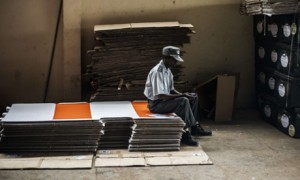 A policeman guards election kits at a warehouse in Maputo. Photograph: Gianluigi Guercia/AFP/Getty Images