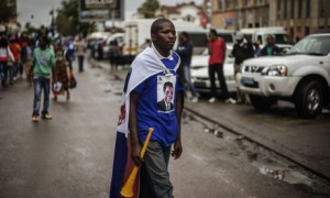 A Renamo supporter takes part in a motorcade campaign rally on 11 October 2014 in Maputo. Photograph: Gianluigi Guercia/AFP/Getty Images