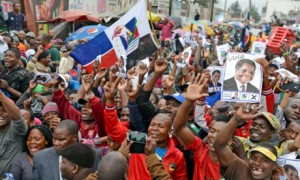Supporters cheer for the Renamo opposition candidate Afonso Dhlakama at rally in Maputo. Photograph: Antonio Silva/EPA