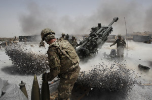U.S. Army soldiers fire a howitzer artillery piece, Afghanistan, June 12, 2011. REUTERS/Baz Ratner